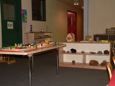 The classroom is set-up to allow children to interact with one another and develop their social skills. For example, early in the year, the train is set out on table. Multiple children can play around the table at the same time. This encourages the children to co-operate and to make friends.