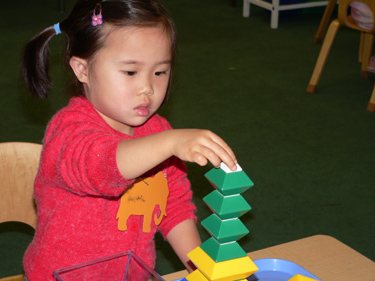 There are toys that encourage small motor and manipulative skills.